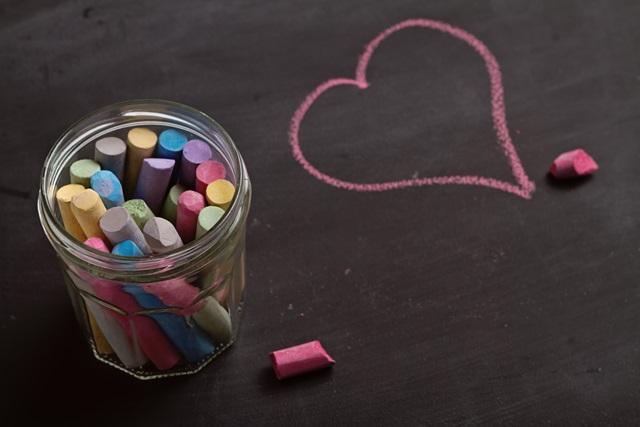 Blackboard, chalk and heart shape drawing